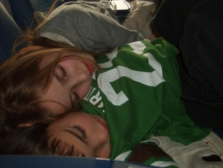 Ayden and Elisha Sleeping on the Plane - Lying together. Precious